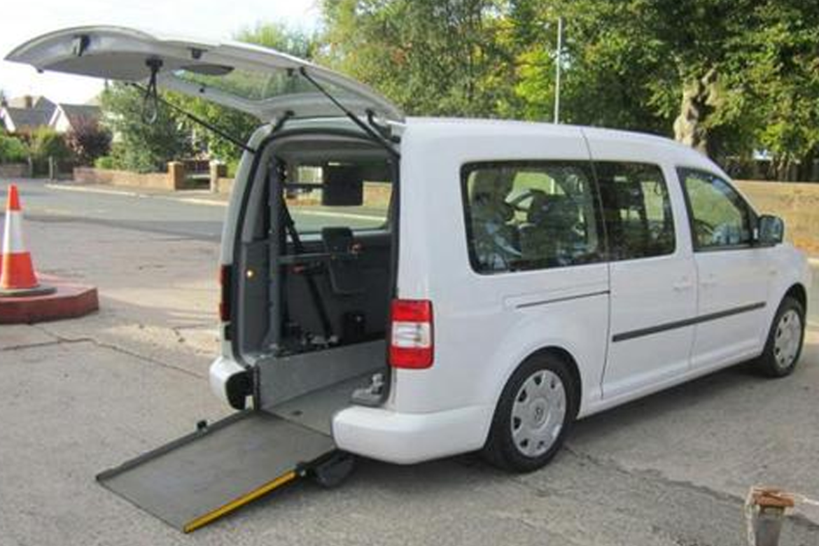 VW Caddy Van with rear door open showing wheelchair lift conversion